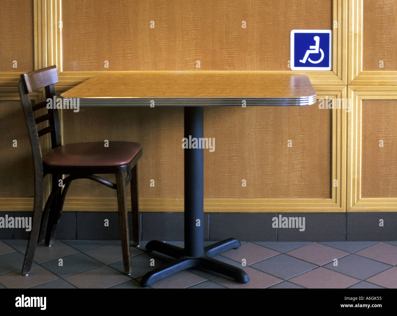 Empty Chair and table with handicap sign Stock Photo: 3777364 - Alamy