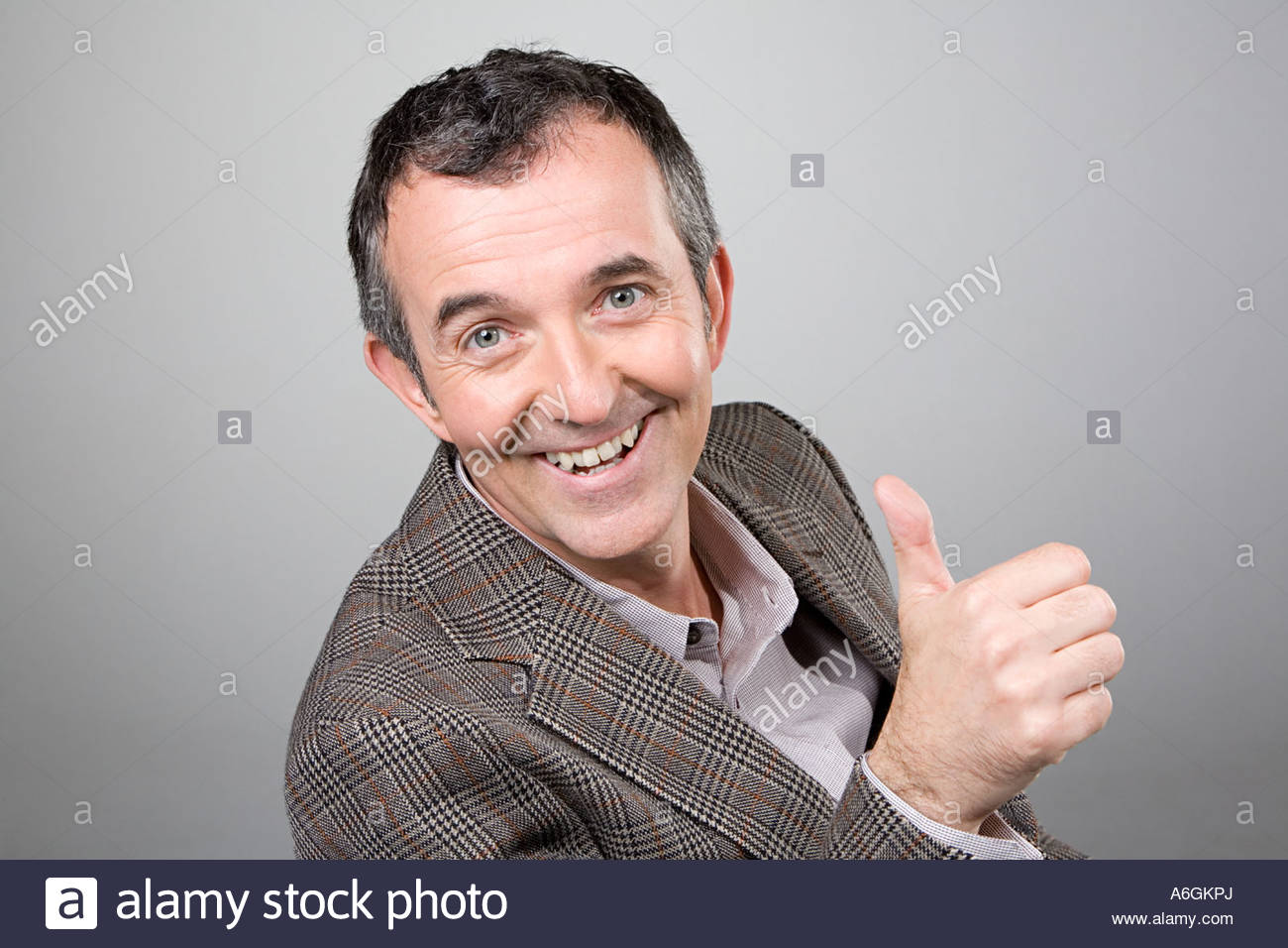 Man giving thumbs up - Stock Image