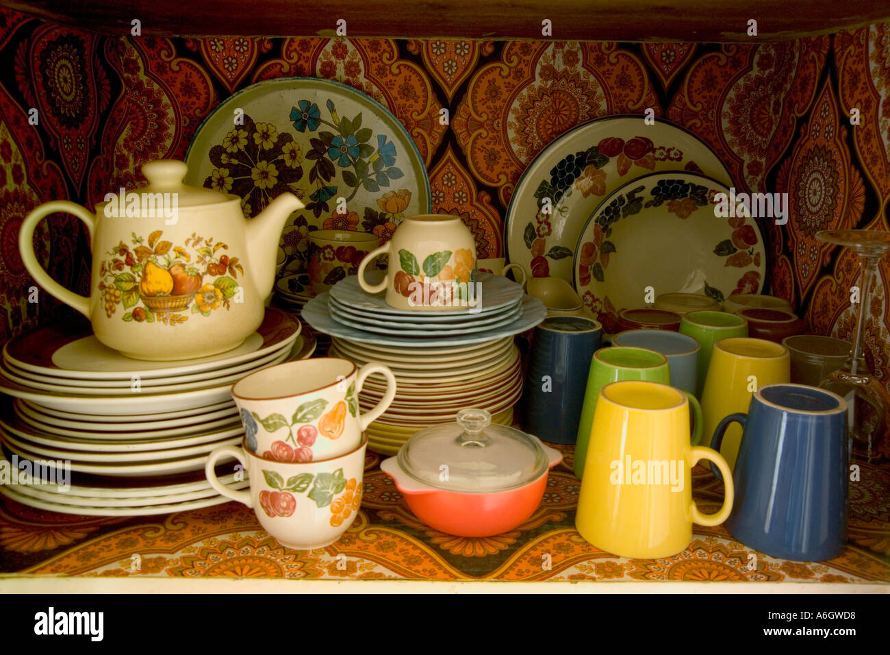 colourful crockery in 1970 s kitchen cupboard patterns & colourful crockery in 1970 s kitchen cupboard patterns Stock Photo ...