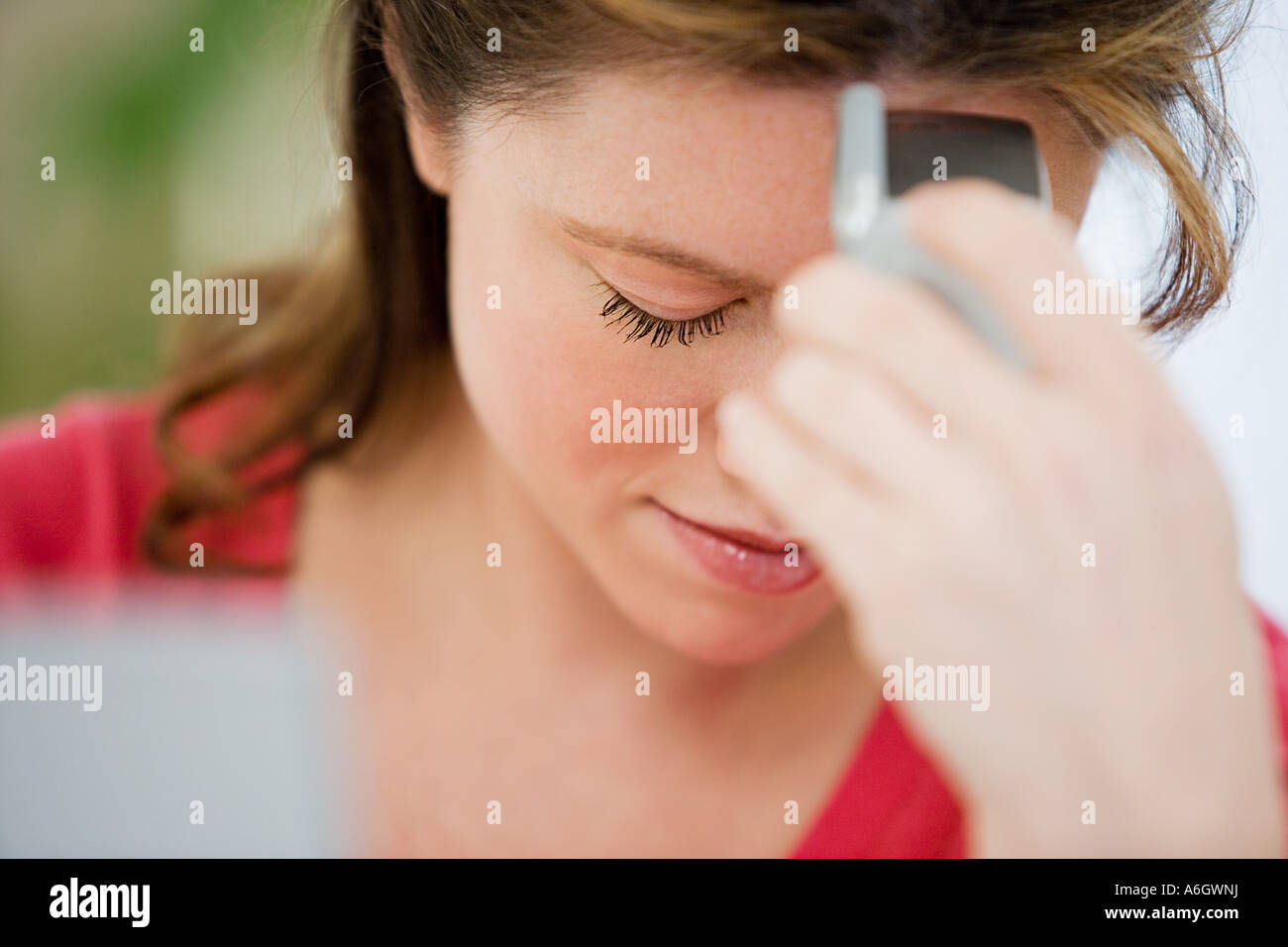 Stressed woman with cellphone - Stock Image