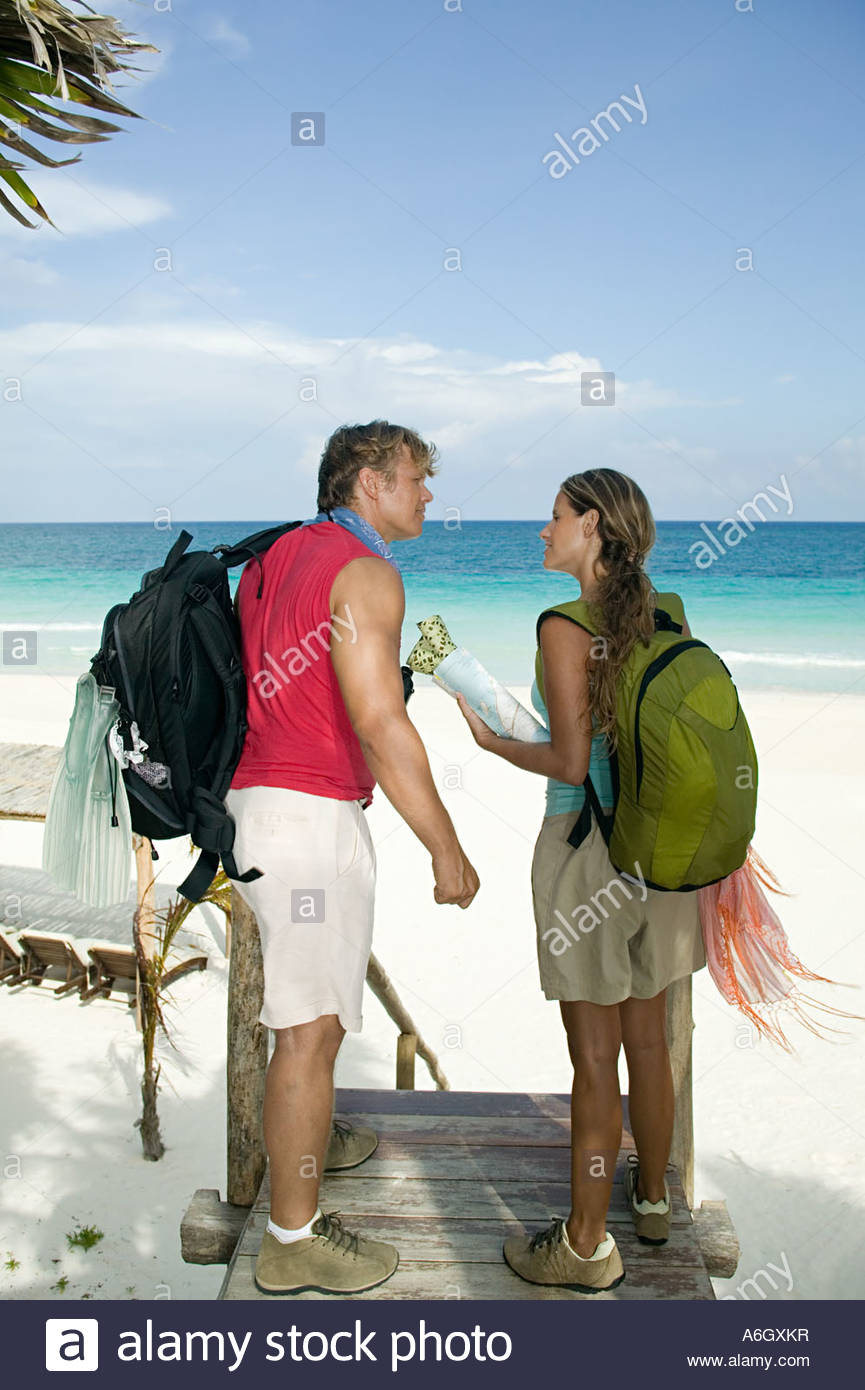 Couple on paradise beach - Stock Image