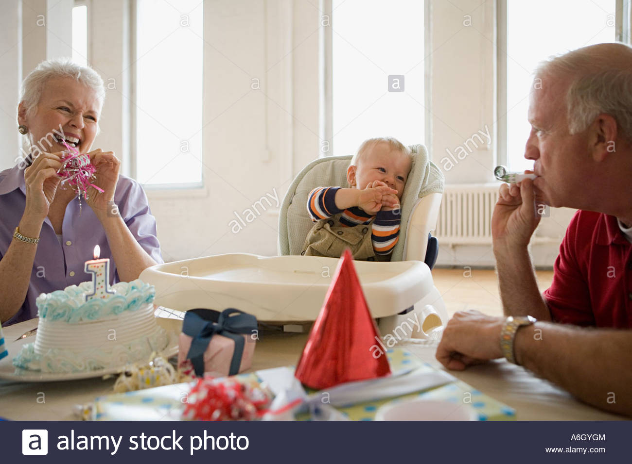 Grandparents at babys birthday party - Stock Image