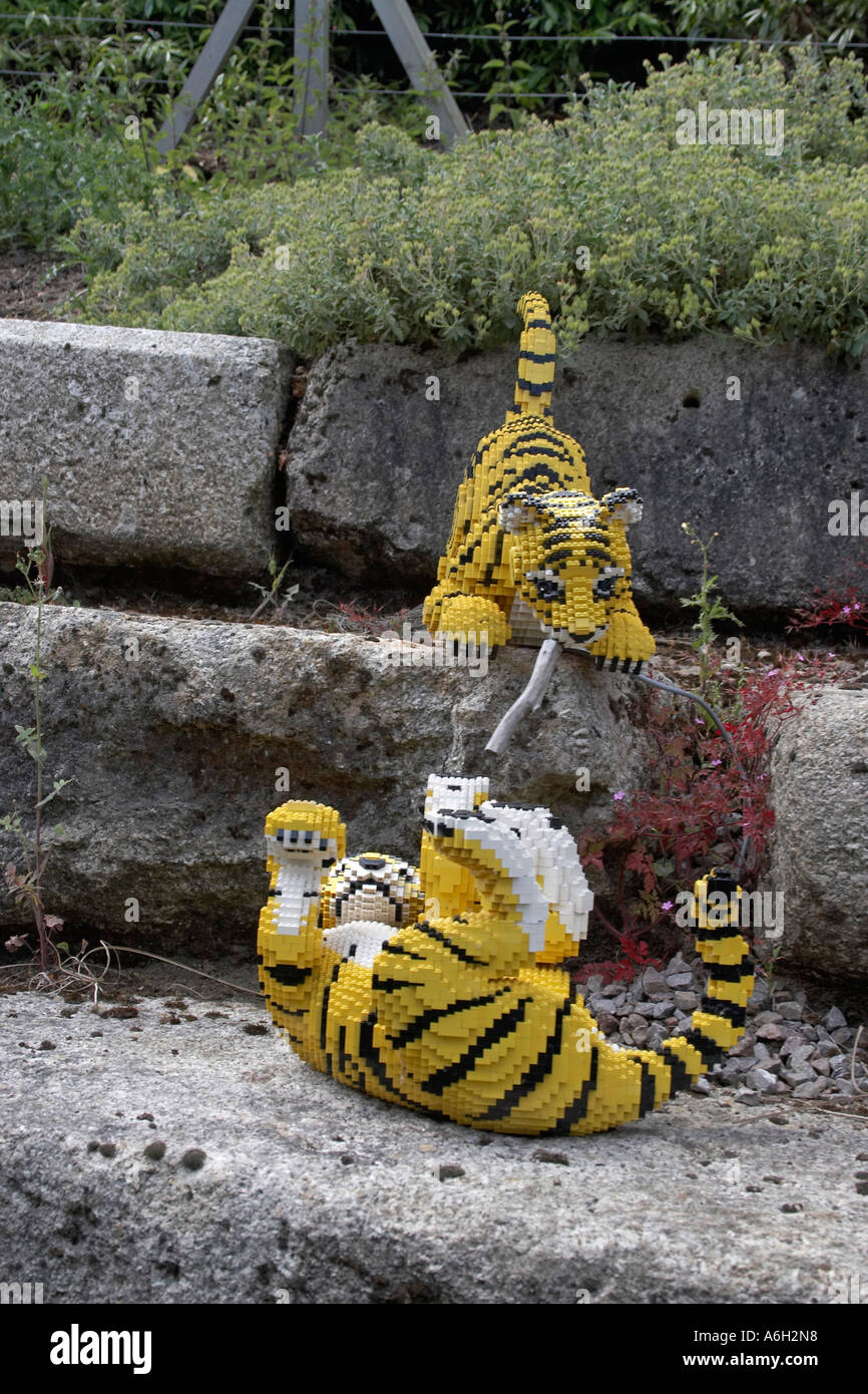 Lego tiger figures on Orient Expedition steam engine train ride in Legoland Stock Photo