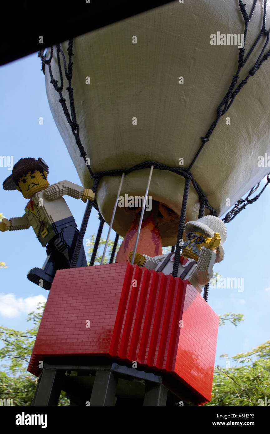 Lego balloonist figures on Orient Expedition steam engine train ride in Legoland Stock Photo
