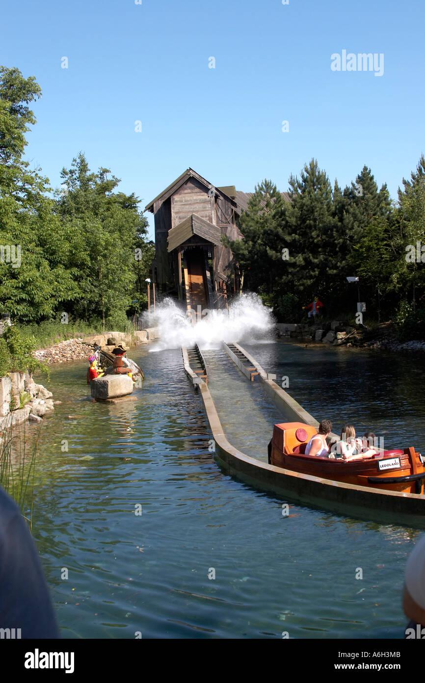 Pirate Falls boat flume ride with cascade splash in Legoland Stock Photo