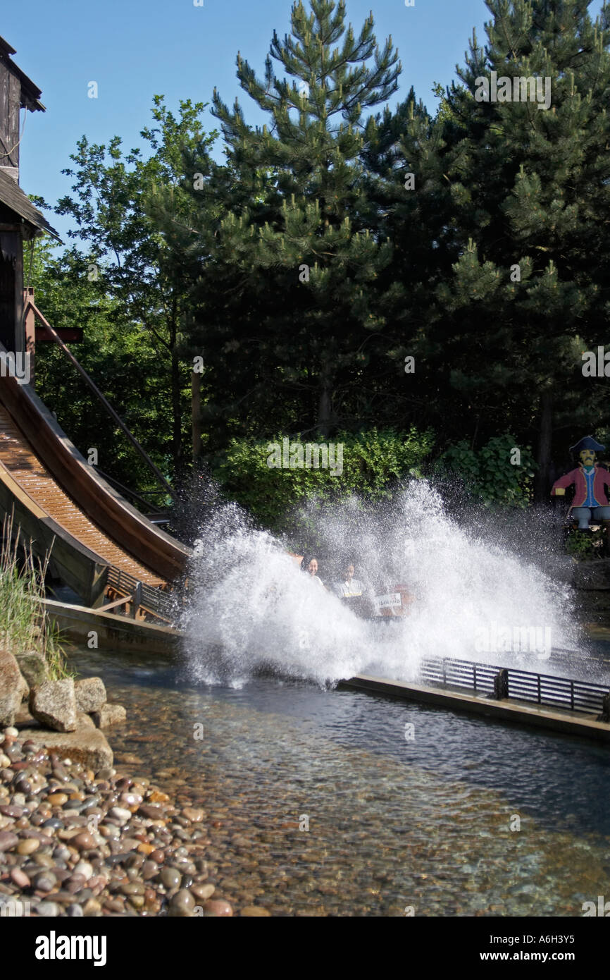 Pirate Falls boat flume ride with cascade splash in Legoland Stock Photo