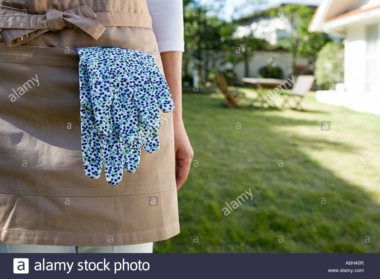 Gardening gloves in an apron pocket - Stock Image