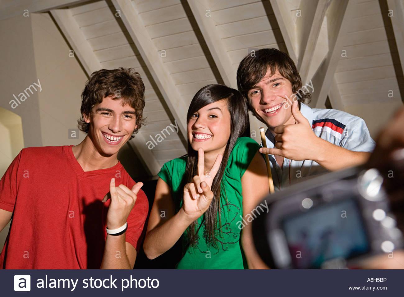 Teenagers having photograph taken - Stock Image