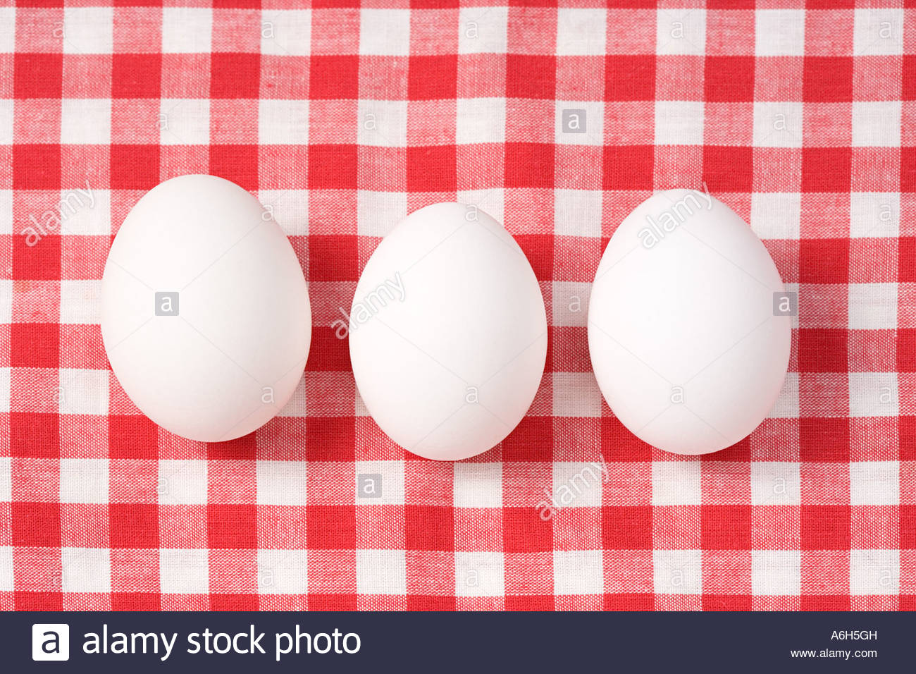 Eggs on a tablecloth - Stock Image