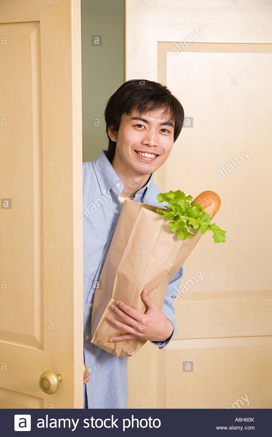 Man with groceries - Stock Image