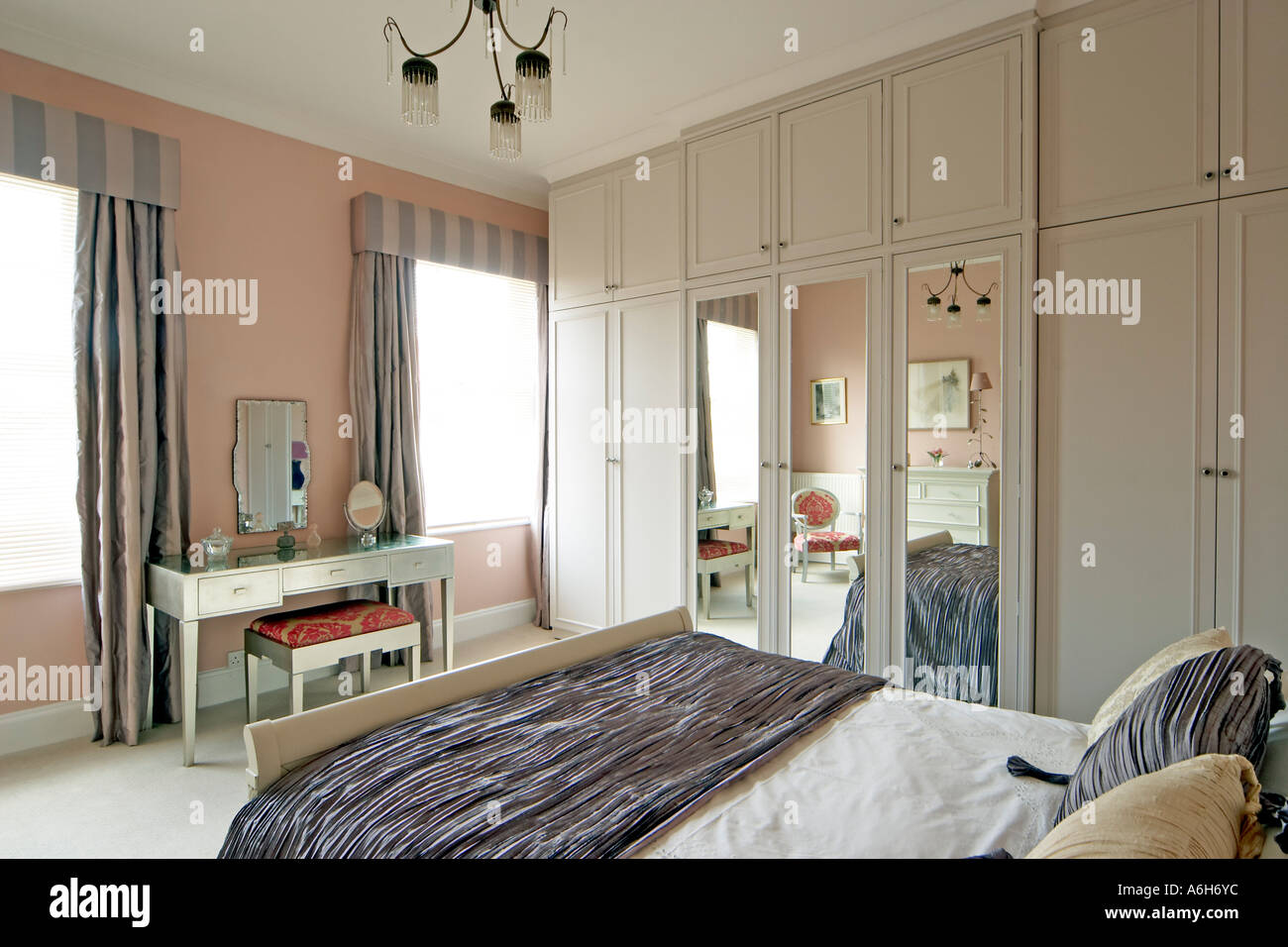 Bedroom With Bed Furniture Cupboards And Mirror In London House Styled By  Interior Designer Eve Wilder