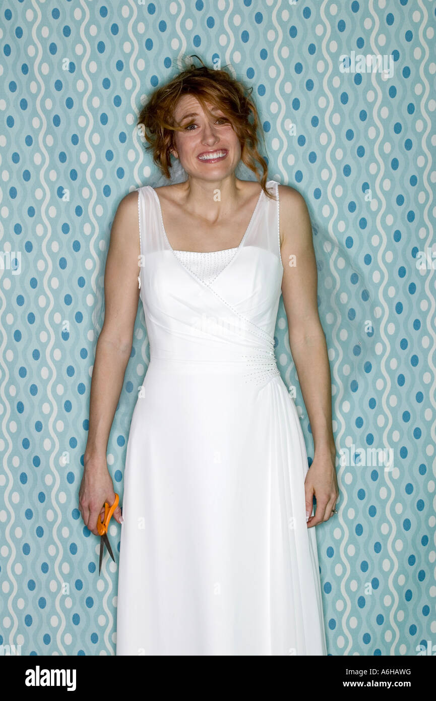 Young Bride In Her Wedding Dress Holding Scissors Having A Bad Hair