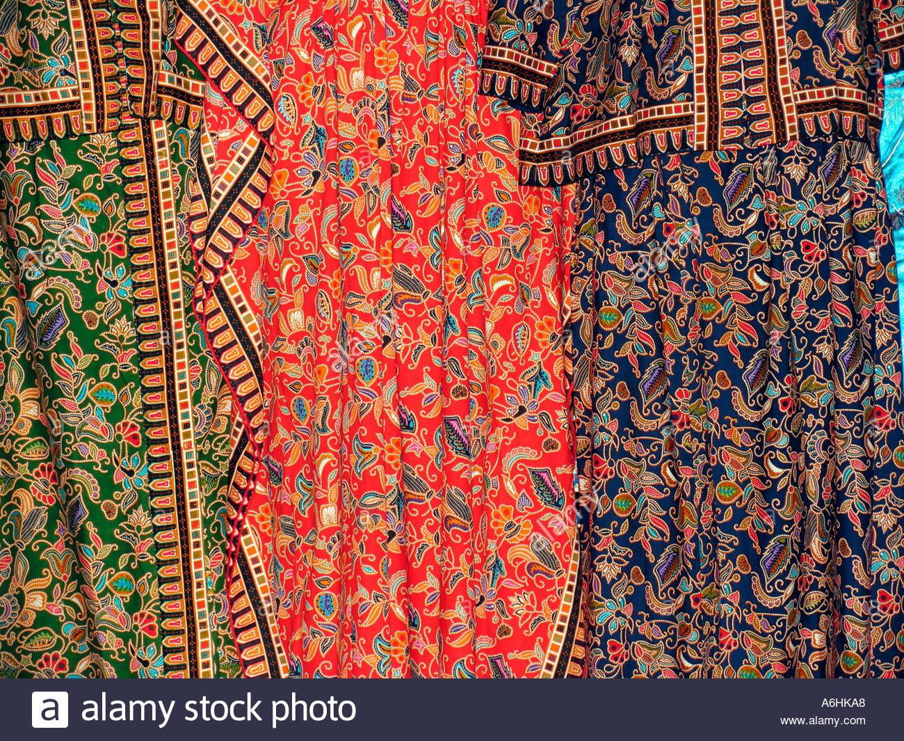 Singaporean womens jacket and skirt display - Stock Image
