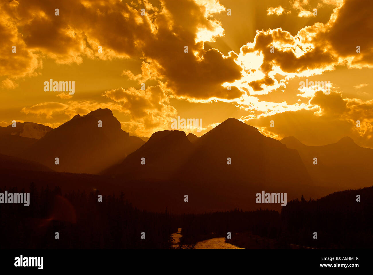 Inspirational image of sunlight over mountains. - Stock Image