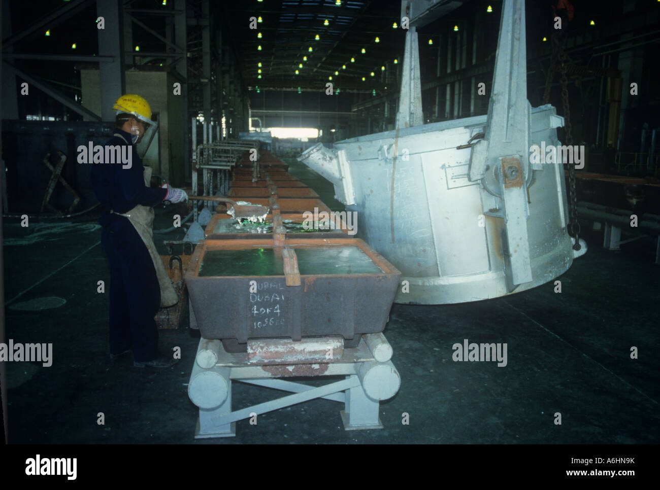Pouring molten aluminium at DUBAL plant, Dubai , UAE Stock