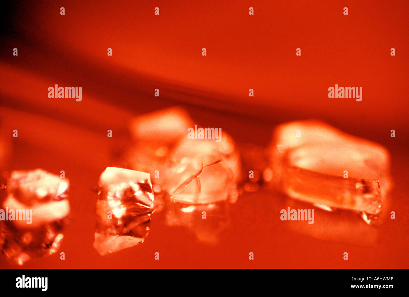 ice fragments on red background - Stock Image
