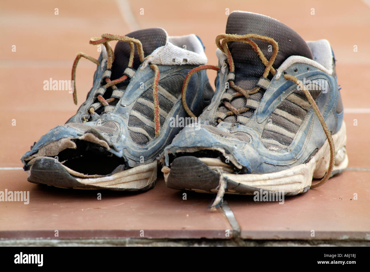 Old trainers. Worn out shoes - Stock Image