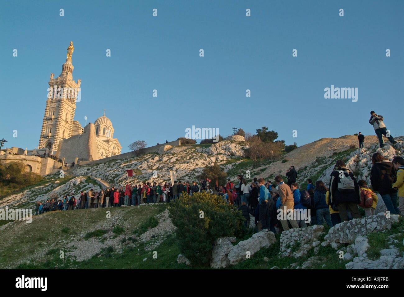 Schoolchildren climbing up to Notre Dame De La Garde Basilica in Marseille, France - Stock Image