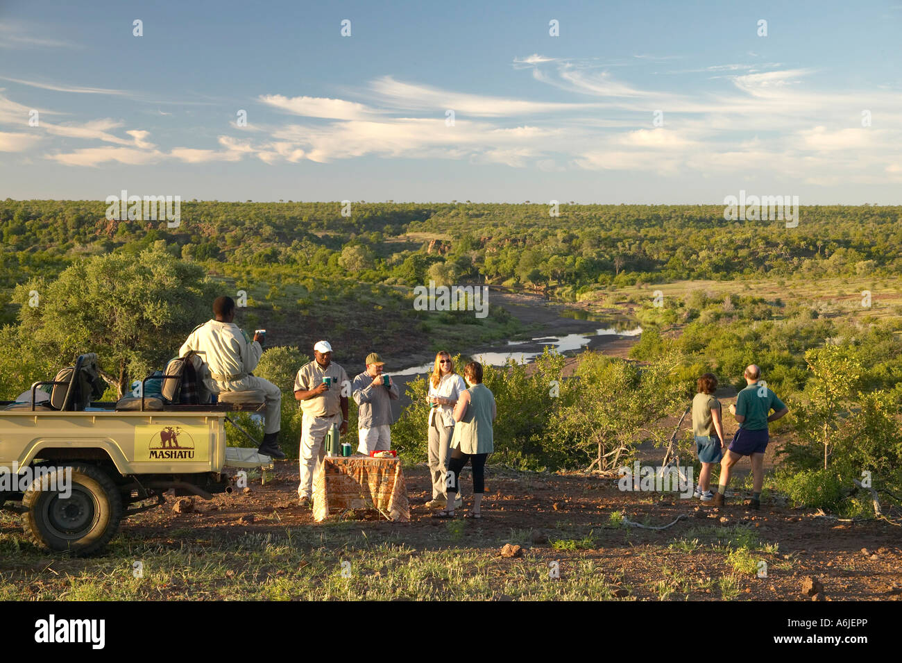 Guests on early morning game drive having a coffee break. Mashatu Game Reserve Northern Thuli Block Botswana - Stock Image