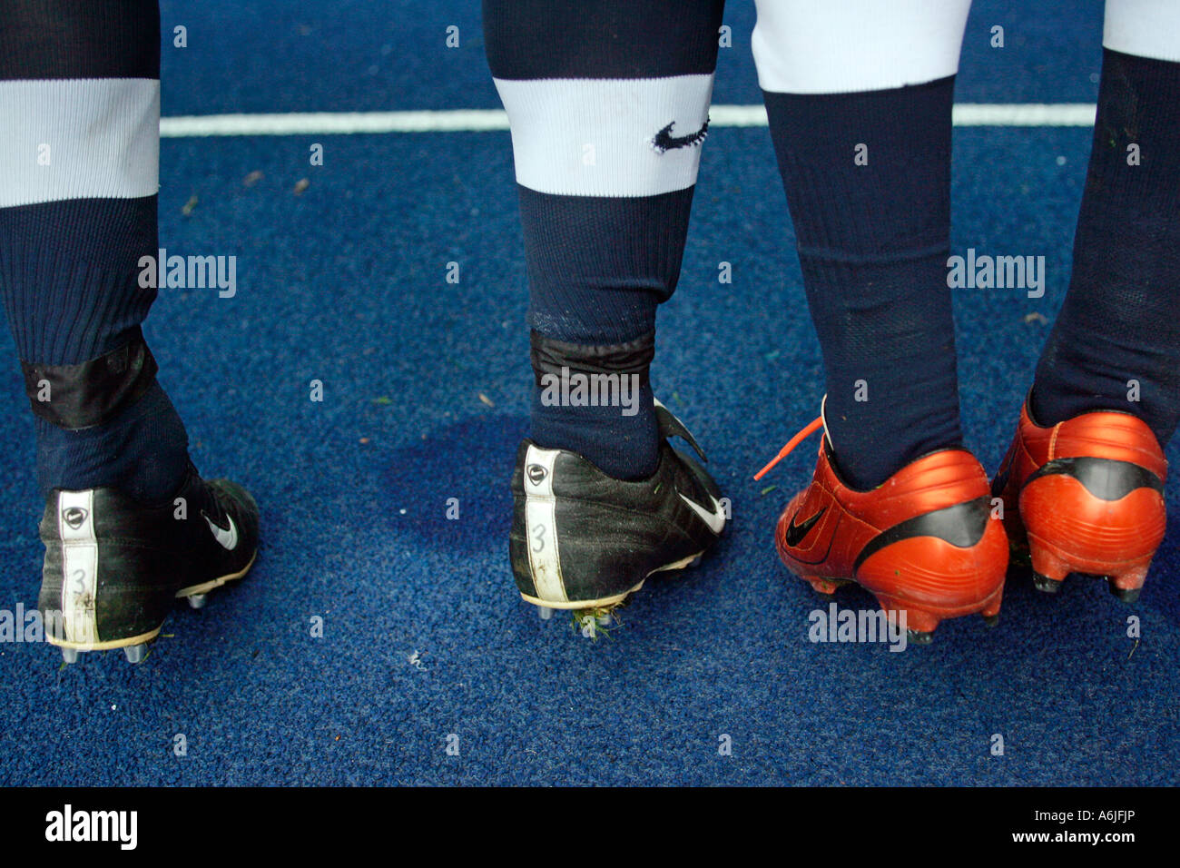 Legs of football players - Stock Image