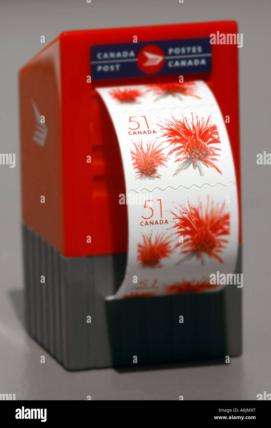 Miniature Canada Post Stamp Dispenser In The Shape Of A Mailbox And 51 Cent Stamps