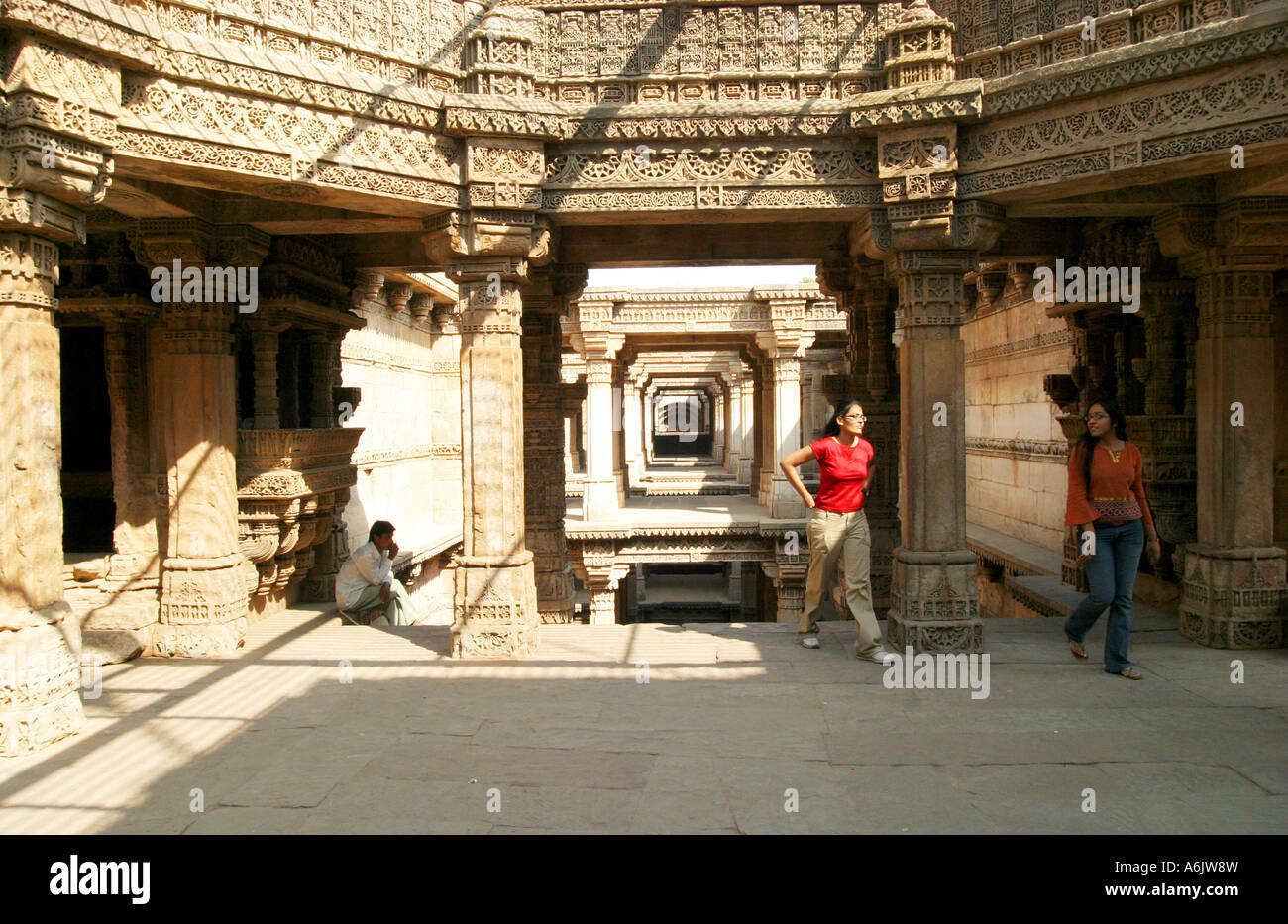 visitors to the exquisitely carved historic Adalaj Step-well near Ahmedabad,Gujarat,India - Stock Image