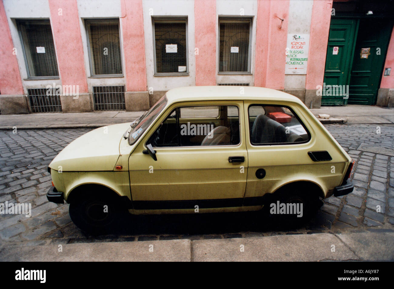 old fashioned small green car in old town Budapest Hungary Eastern ...