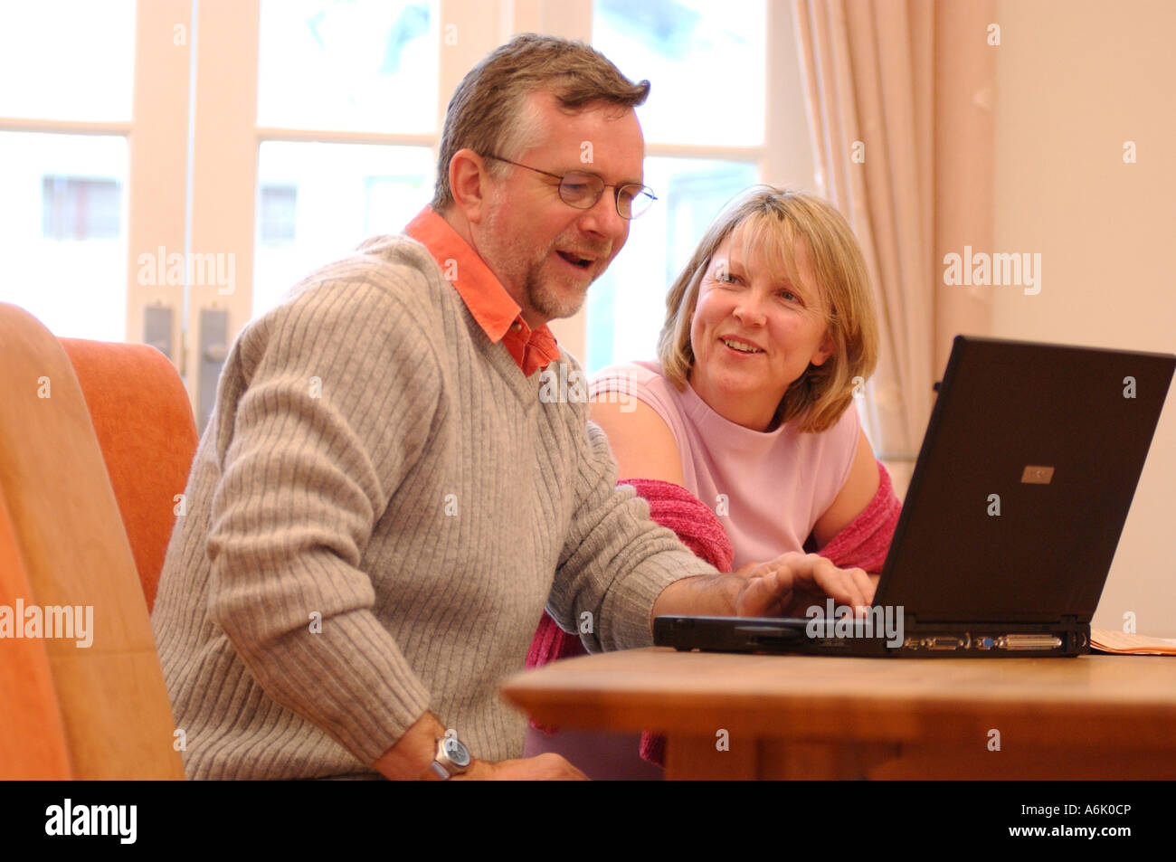 British business man and woman casual clothes working in office London UK - Stock Image