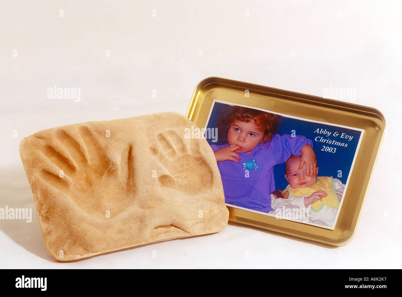 Keepsake - Hand Prints of 3 Month Old Baby & 2 Year Old Sisters USA - Stock Image