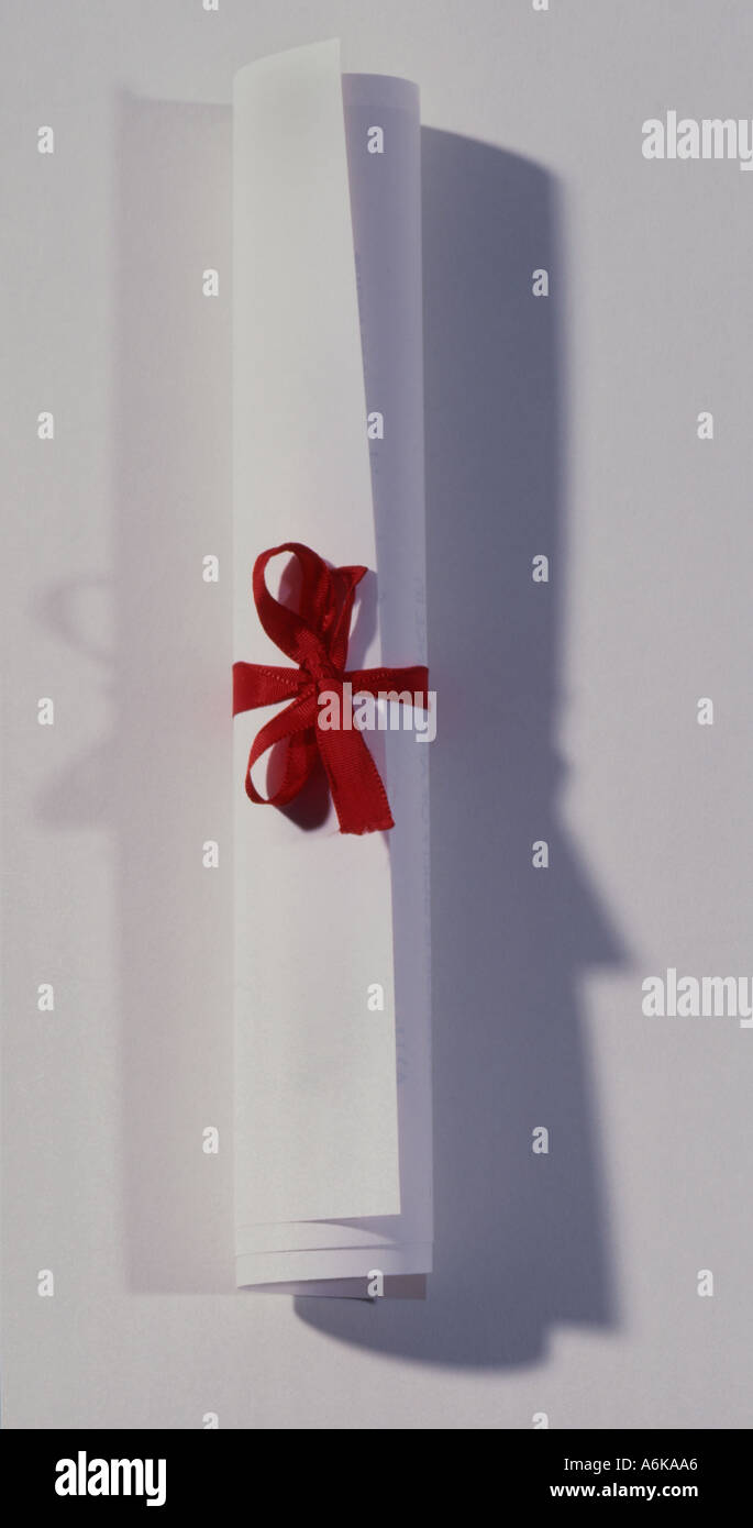 White scroll award tied with red ribbon - Stock Image