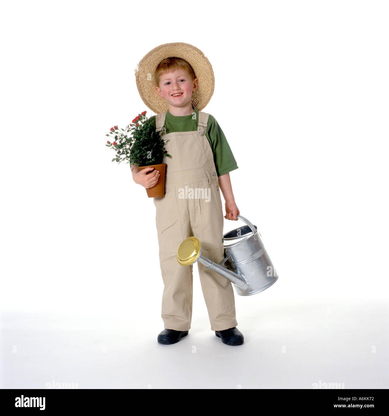 Little boy dressed as gardener - Stock Image