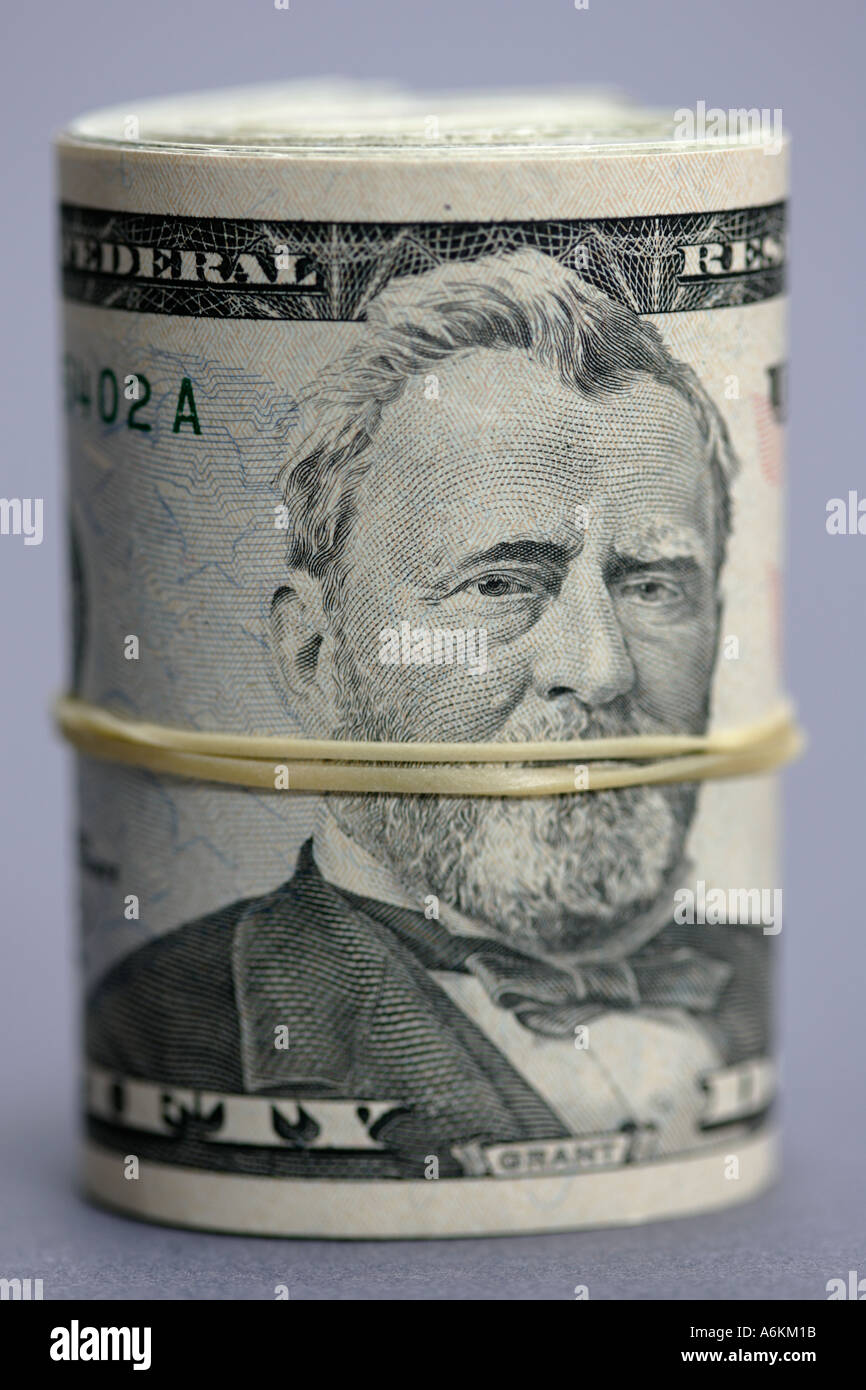 US currency roll of fifty dollar bills close up - Stock Image