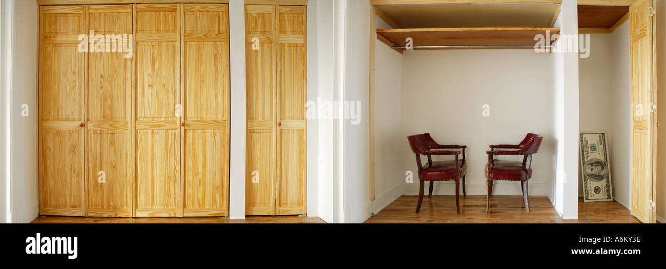 Two old armchairs inside cabinet Huge size 100 dollar bill lean against wall inside wardrobe - Stock Image