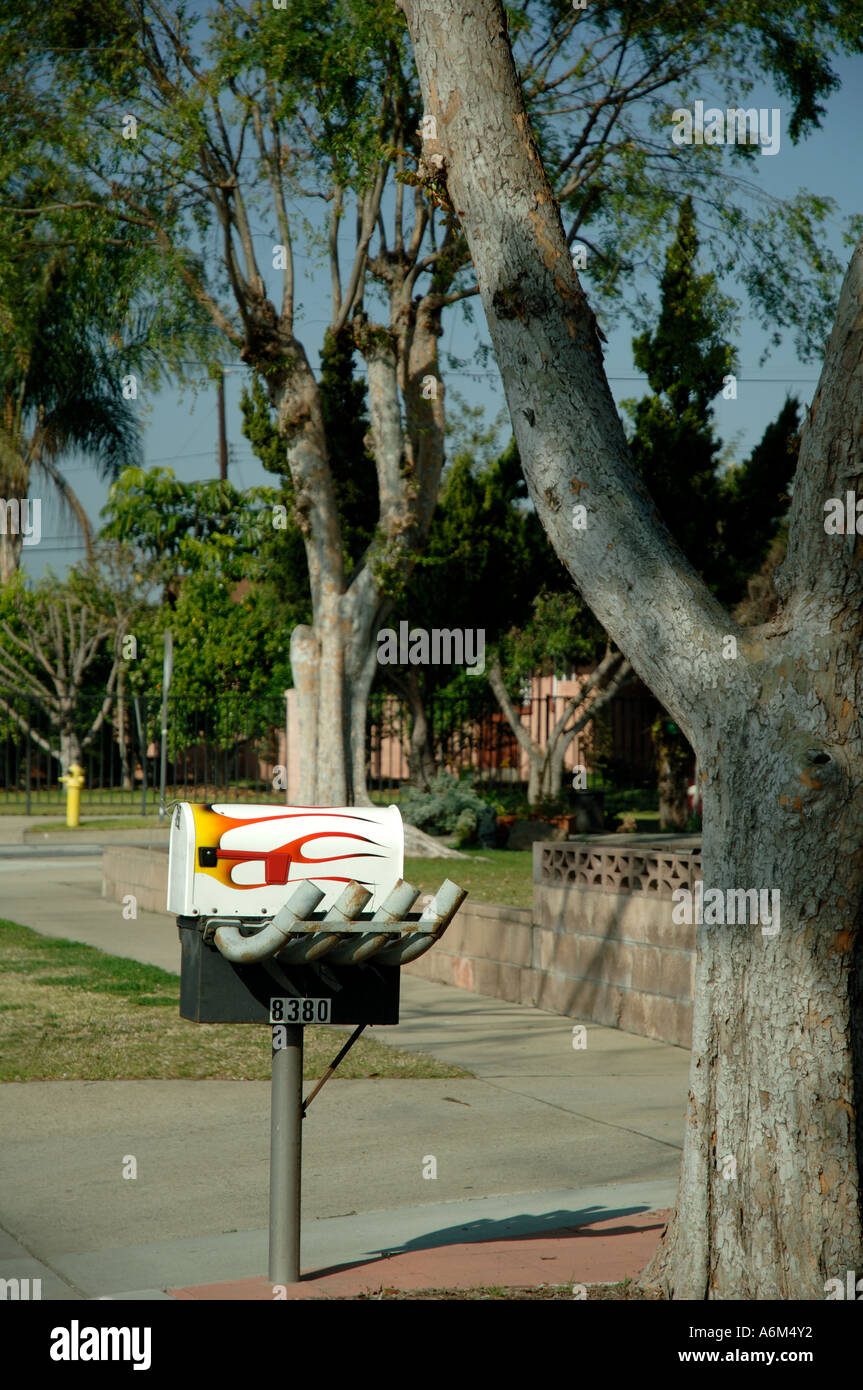 Mailbox with painted flames and exhaust pipes. Concept fast speed speedy postal service. & Mailbox with painted flames and exhaust pipes. Concept fast speed ...