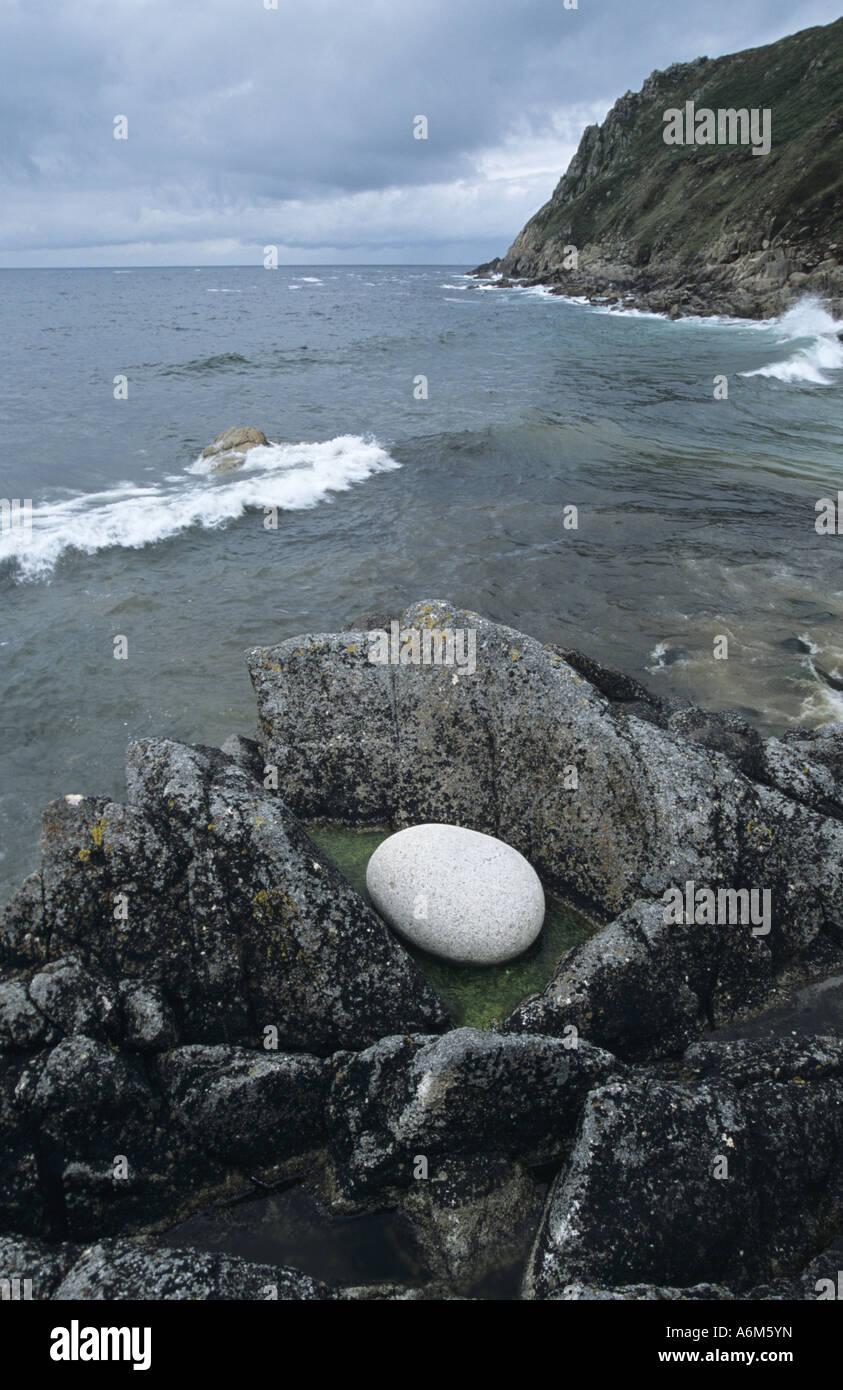 'Dinosaur Egg' shaped rock at Porth Nanven  Cornwall UK - Stock Image