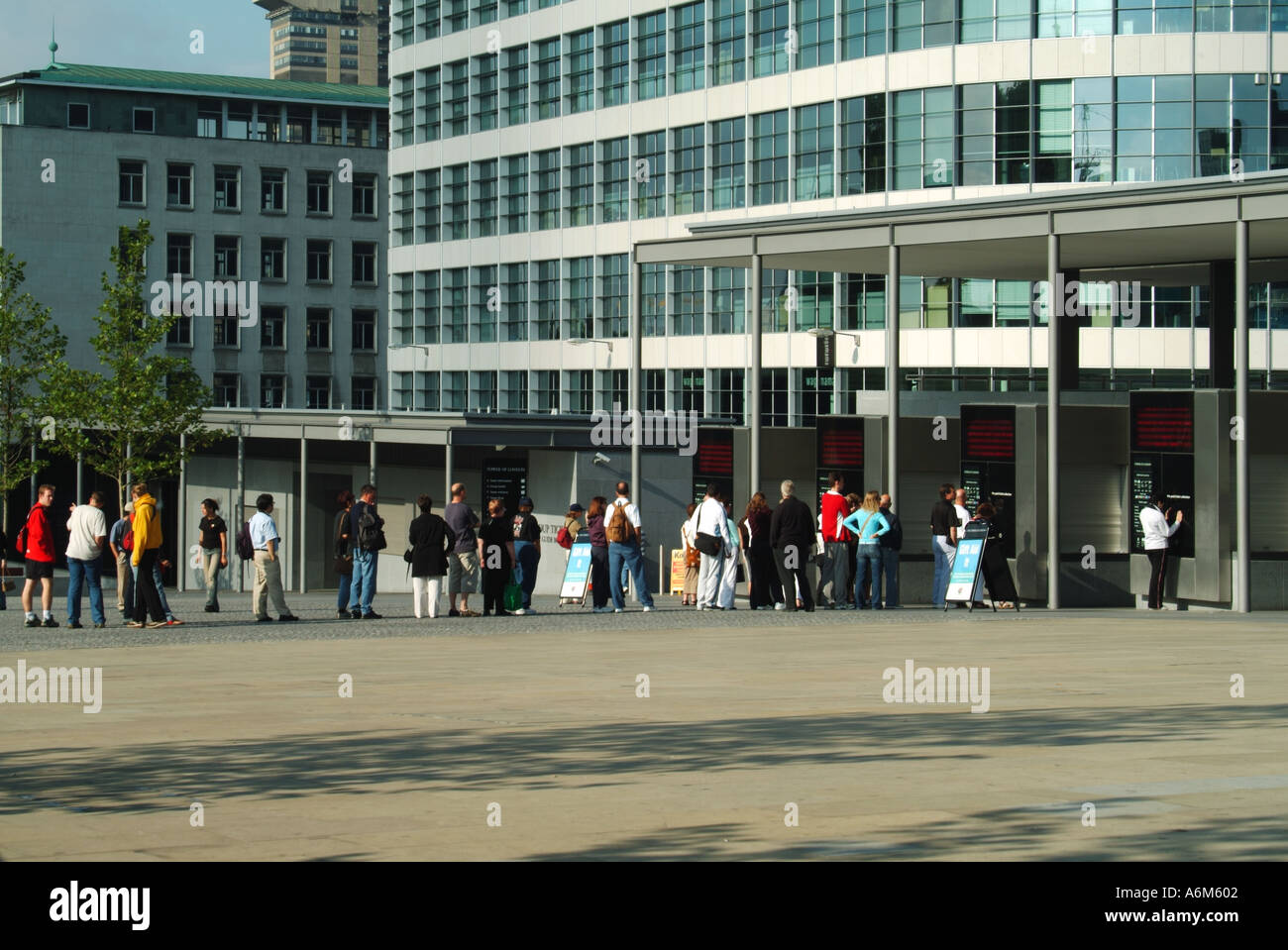 Tower Hill remodelled approach areas to the Tower of London with early morning queues waiting for ticket booths Stock Photo
