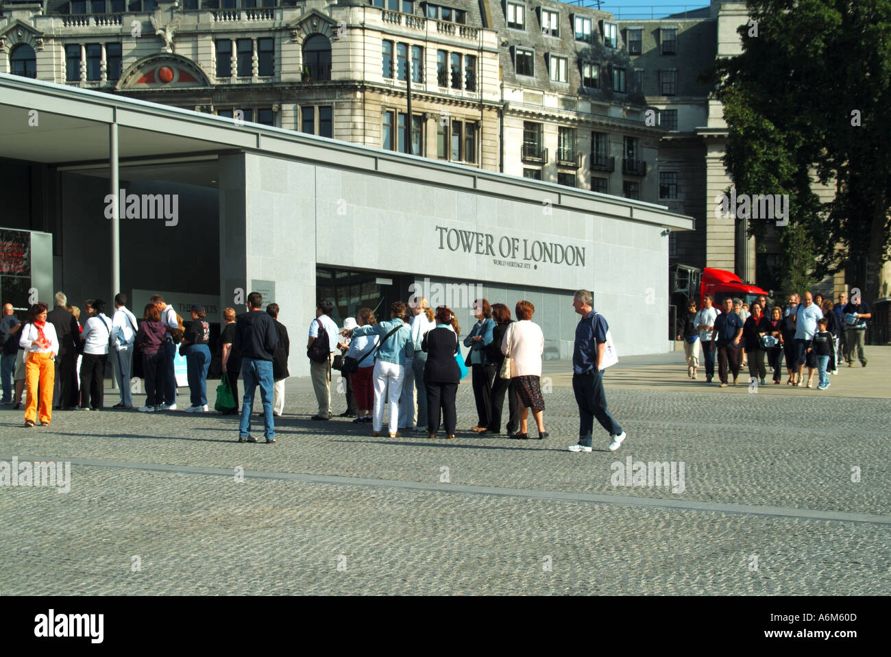 Tower Hill remodelled approach areas to the Tower of London early morning queues waiting for ticket booths to open Stock Photo