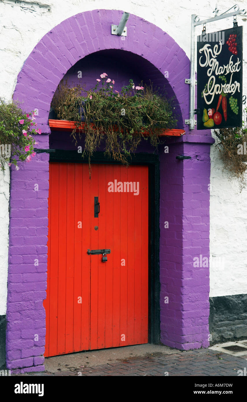 Red door with a purple arch define the entrance to the Market Garden in Kinsale County Cork Ireland & Red door with a purple arch define the entrance to the Market Garden ...