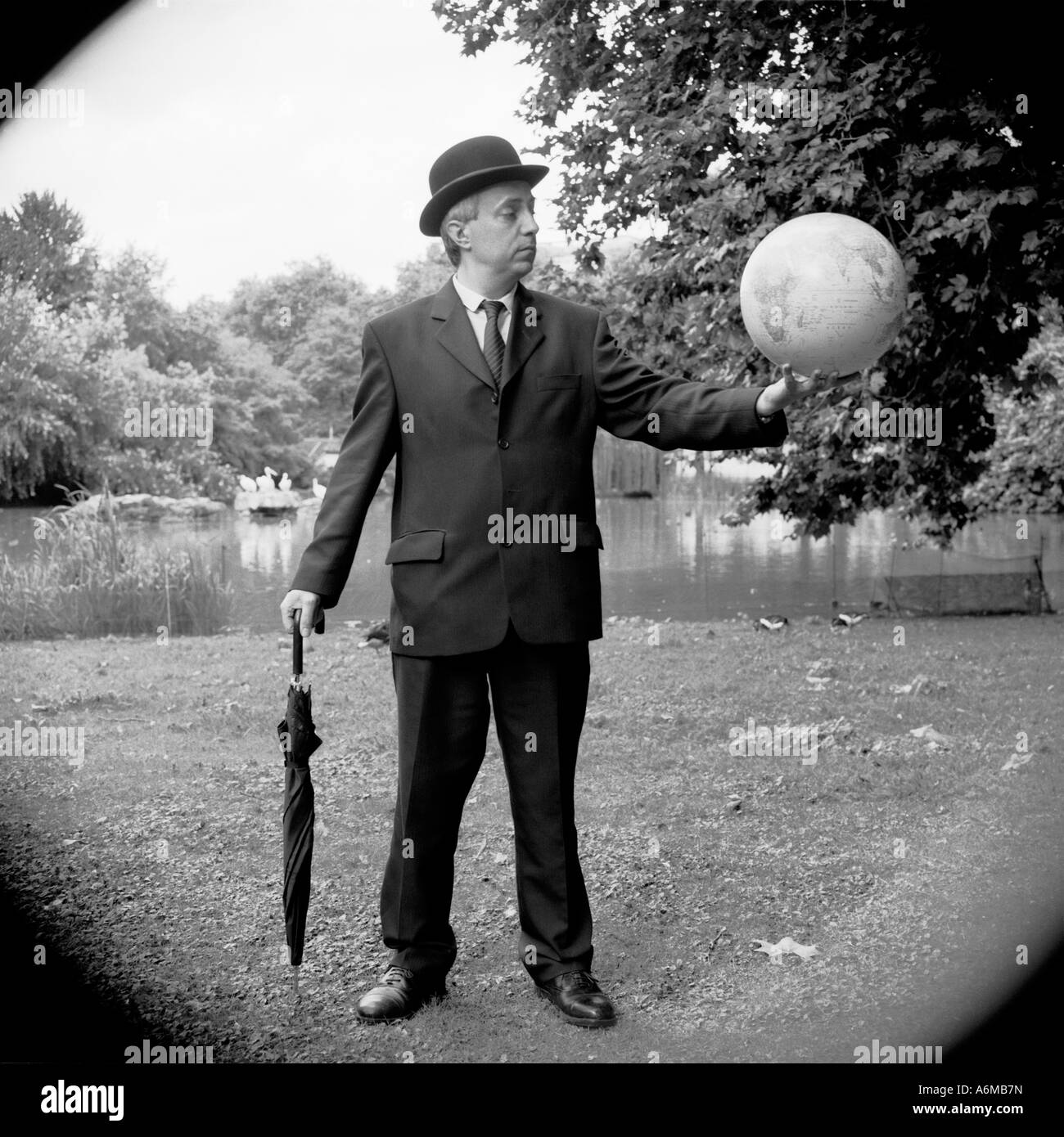 City gent with globe in his hands - Stock Image