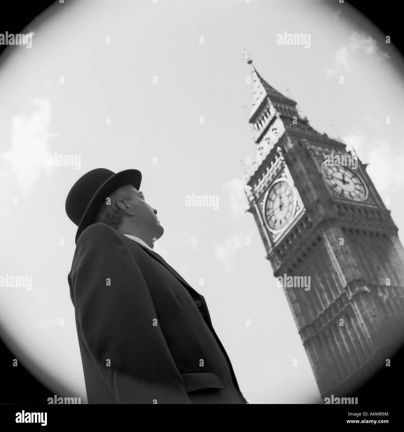 City gent looking at Big Ben clock Stock Photo