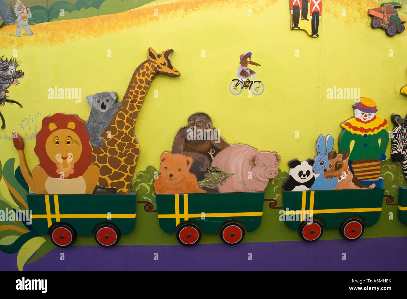 Colourful mural painting of zoo animals in train in Katikati township Bay of  Plenty New Zealand - Stock Image