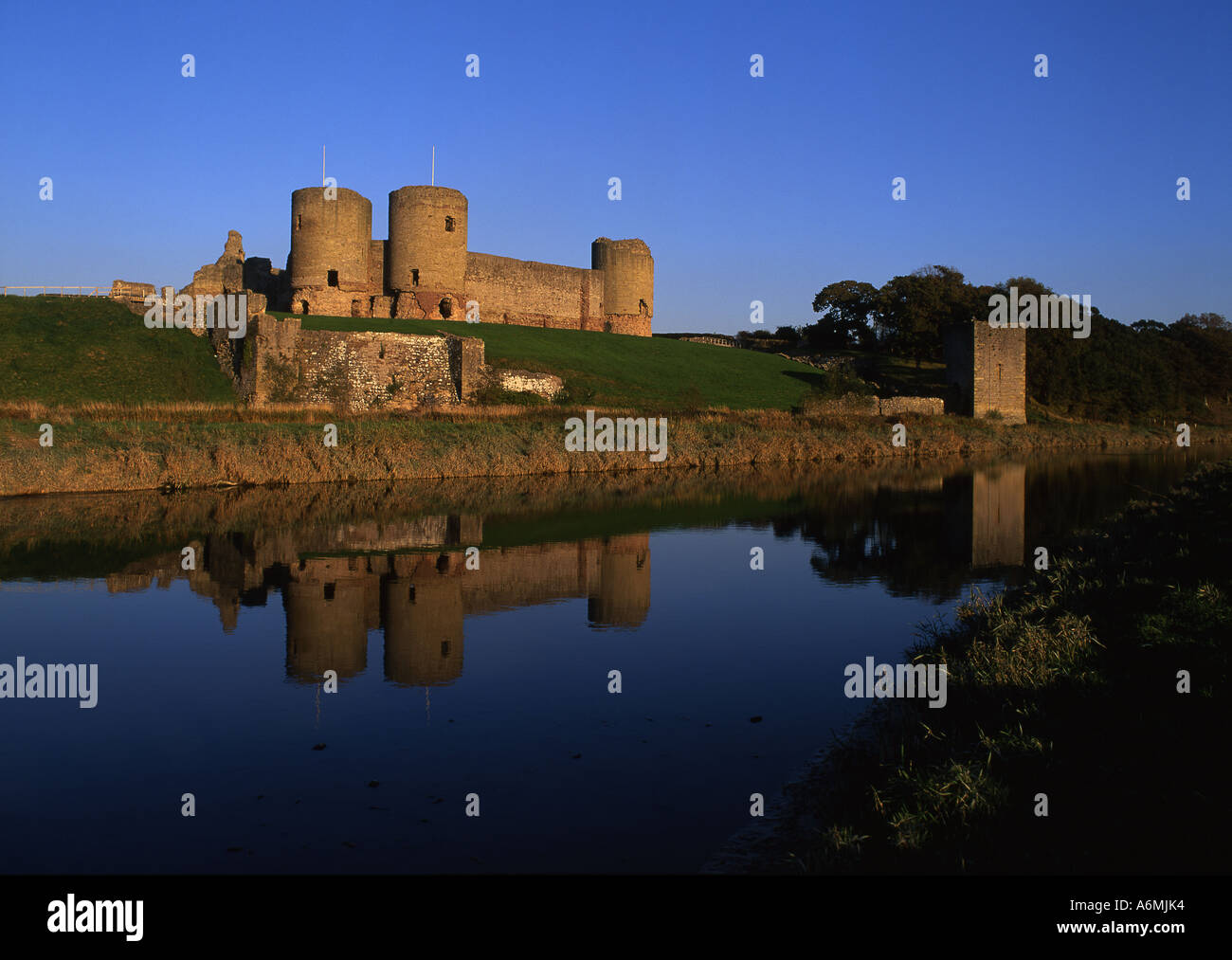 Rhuddlan Castle 13th 14th century Reflected in river Elwy 2 miles south of Rhyl Denbighshire North Wales UK - Stock Image