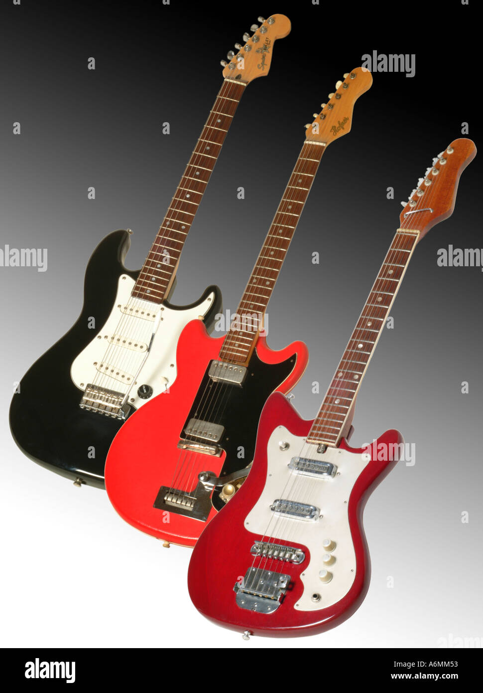 3 different electric guitars on black white grad background - Stock Image