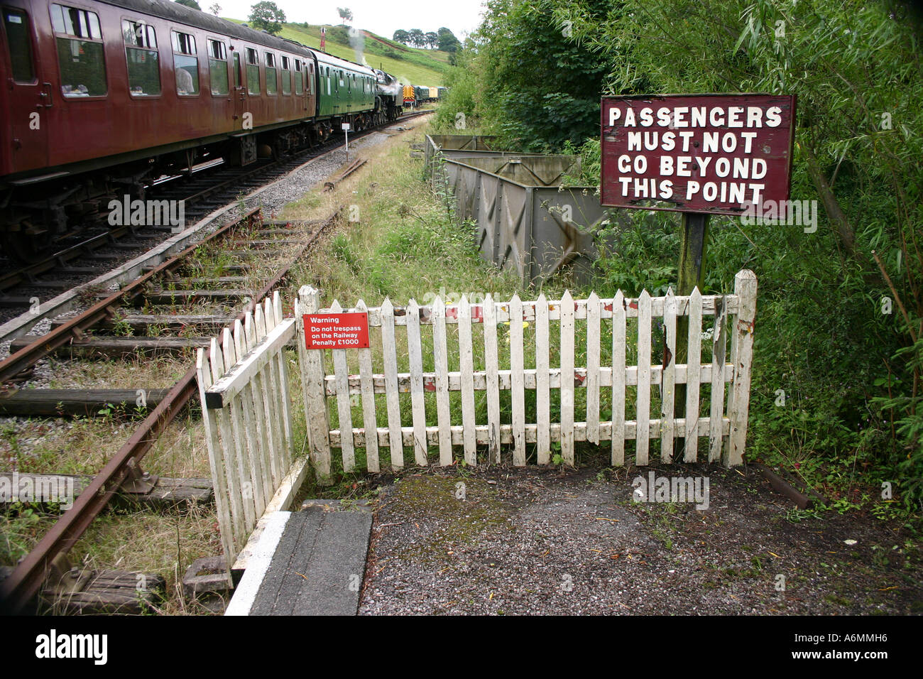 Passengers must not go beyond this point sign on steam railway at Cheddleton station, Staffordshire - Stock Image