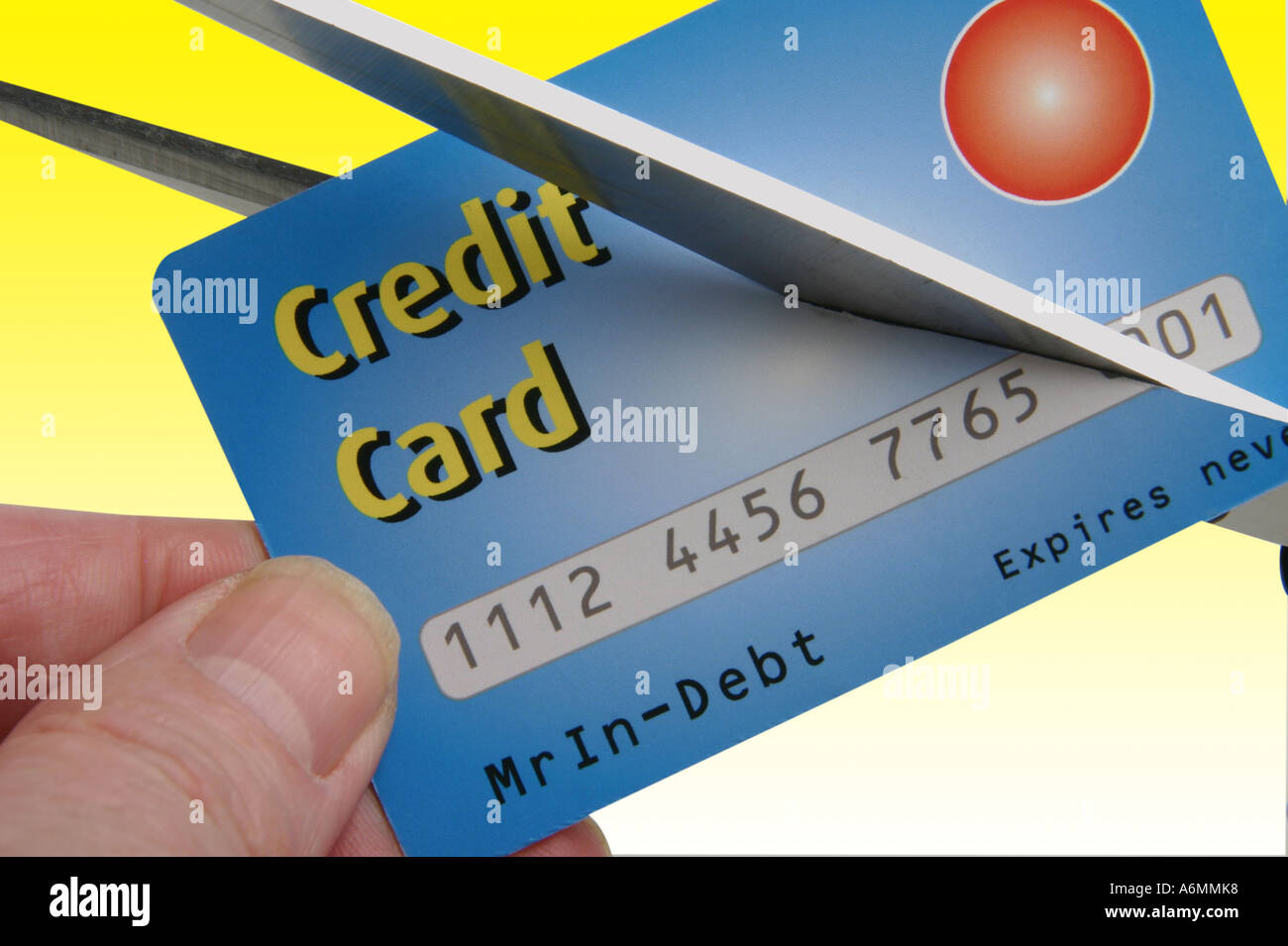 Credit card being cut in half by scissors Stock Photo: 6634295 - Alamy