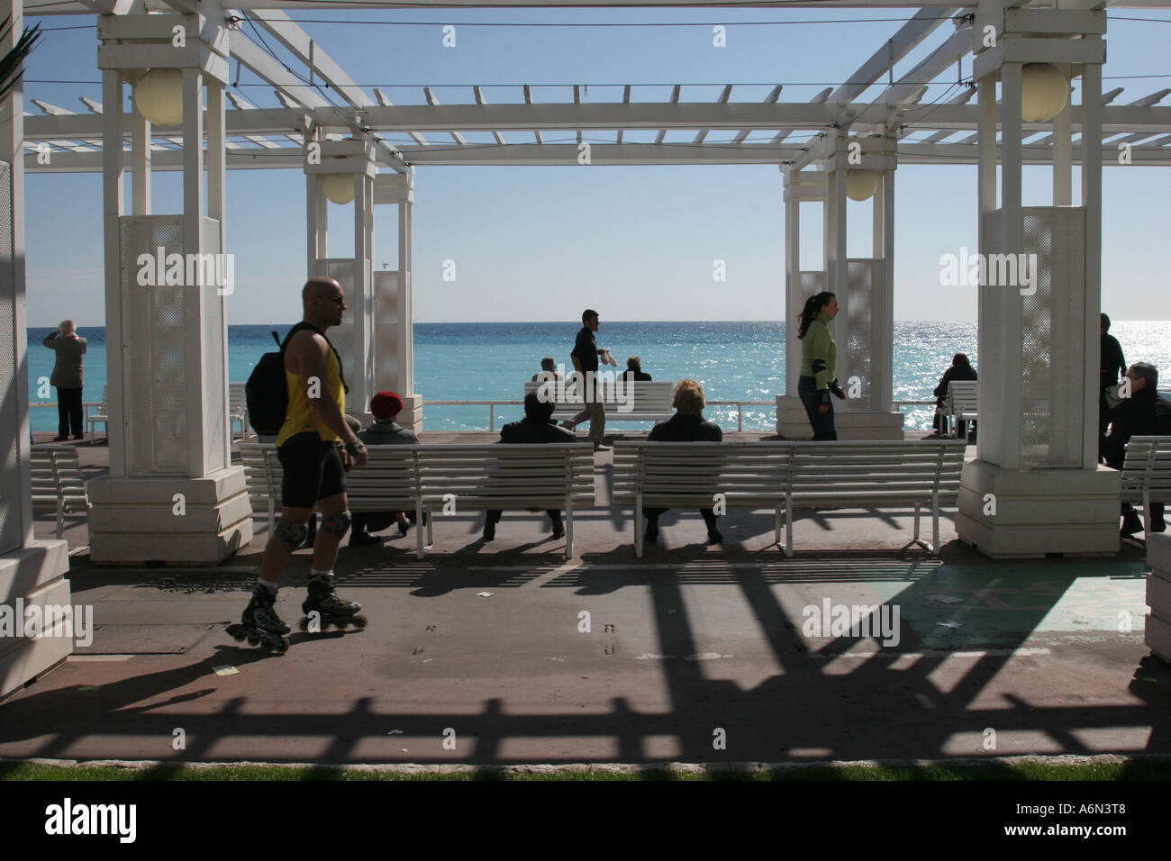 roller skater activity on the promenade des anglais, nice, cote d'azur, France people sitting on benches watching Stock Photo
