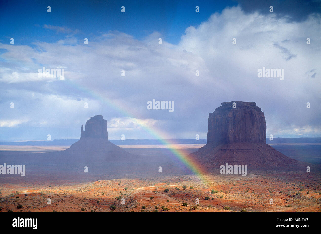 a rainbow over Monument Valley Utah USA - Stock Image
