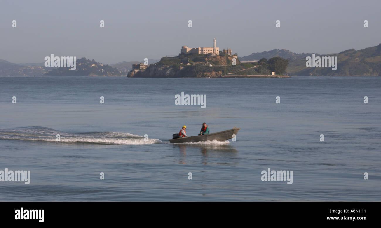Fishing boat passing Alcatraz Island San Francisco Bay California - Stock Image
