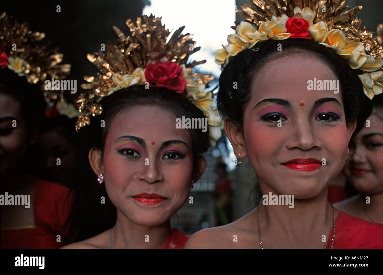 Young brightly dressed smiling Balinese dancers Photographed whilst waiting to perform Ubud Indonesia - Stock Image