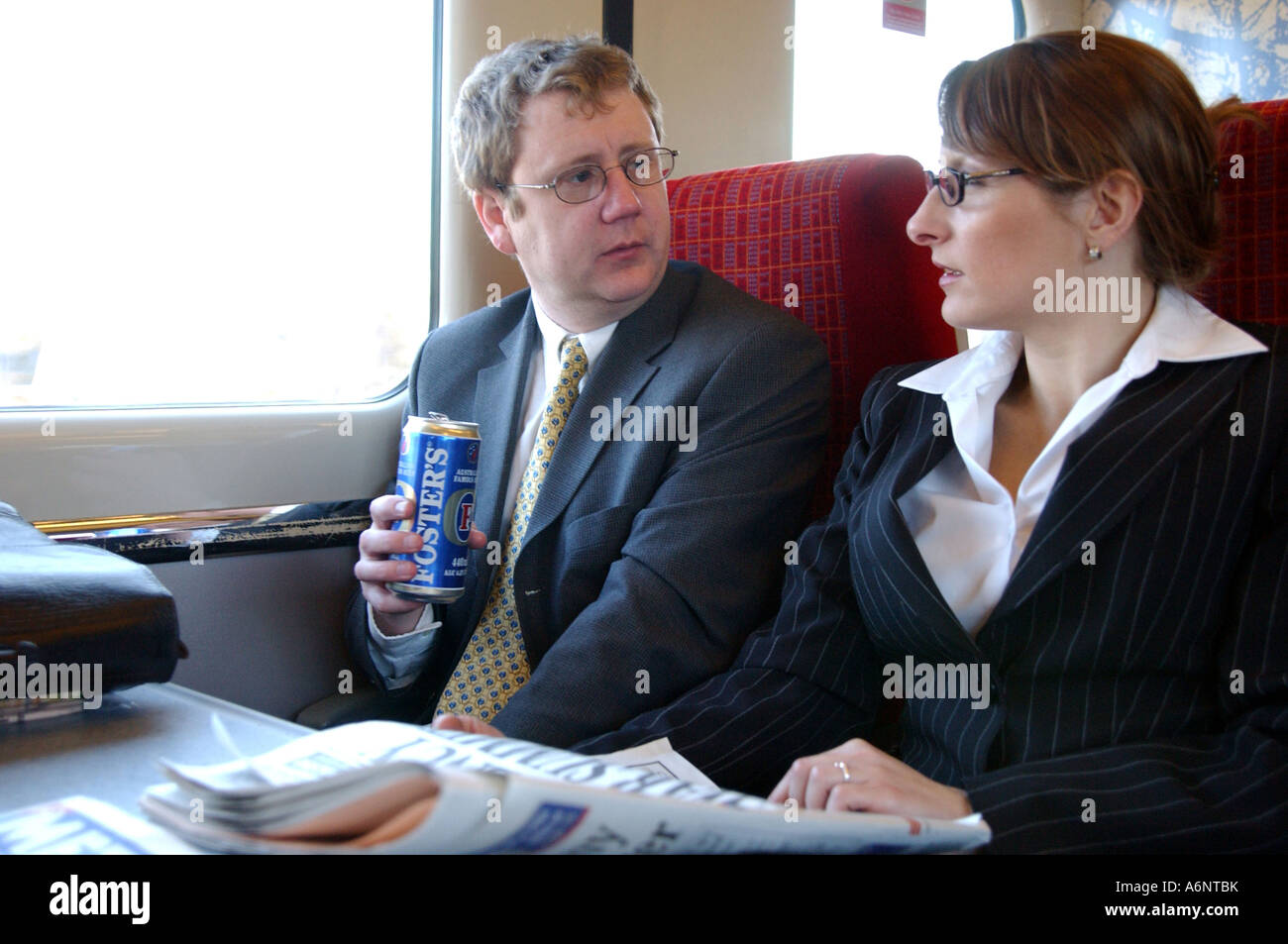 British Business Woman And Man Meeting On Train London Uk